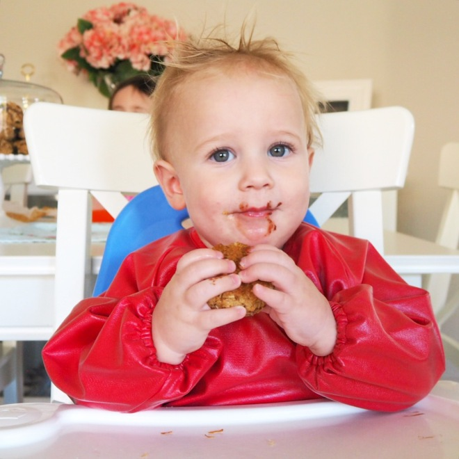 Mr H. wearing the little chomps messy mealtimes smock